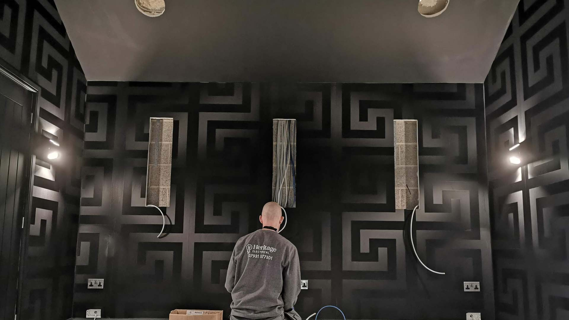 An electrician installing a home cinema in Wilmslow, Cheshire